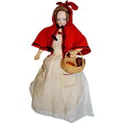 French fashion doll in little red riding hood outfit with doleac face