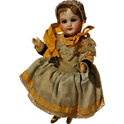 A tiny 301 French SFBJ doll in britanny outfit
