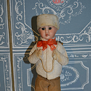 Sweet French candy container in winter costume