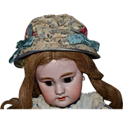 Charming antique hat for doll