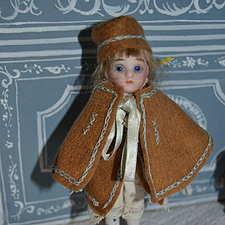 German all bisque doll for your doll's houses in winter trip costume