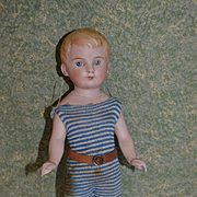 Lovely Antique bathing doll damaged