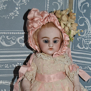 Fabulous Simon and Halbig All bisque doll , with all original little girl outfit