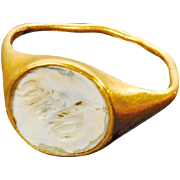 Rare Roman Gold ring with a patinated Carneol intaglio of Pan