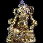Antique and Beautiful Sino-Tibetan Gilt Bronze figure of Jambhala