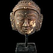 Rare large Burmese 'Stucco over Terracotta' Buddha head, 16th.-18th.