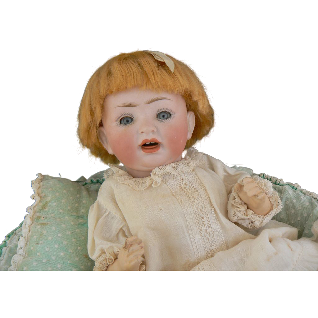 Darling Little 152 German Bisque Baby doll original outfit and basket.