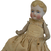 Darling All Bisque Baby Boy Doll Jointed arms and legs. Sweet Face and original.