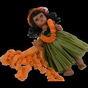 Ginny type doll dressed as a Hawaiian girl 1950's walker doll.