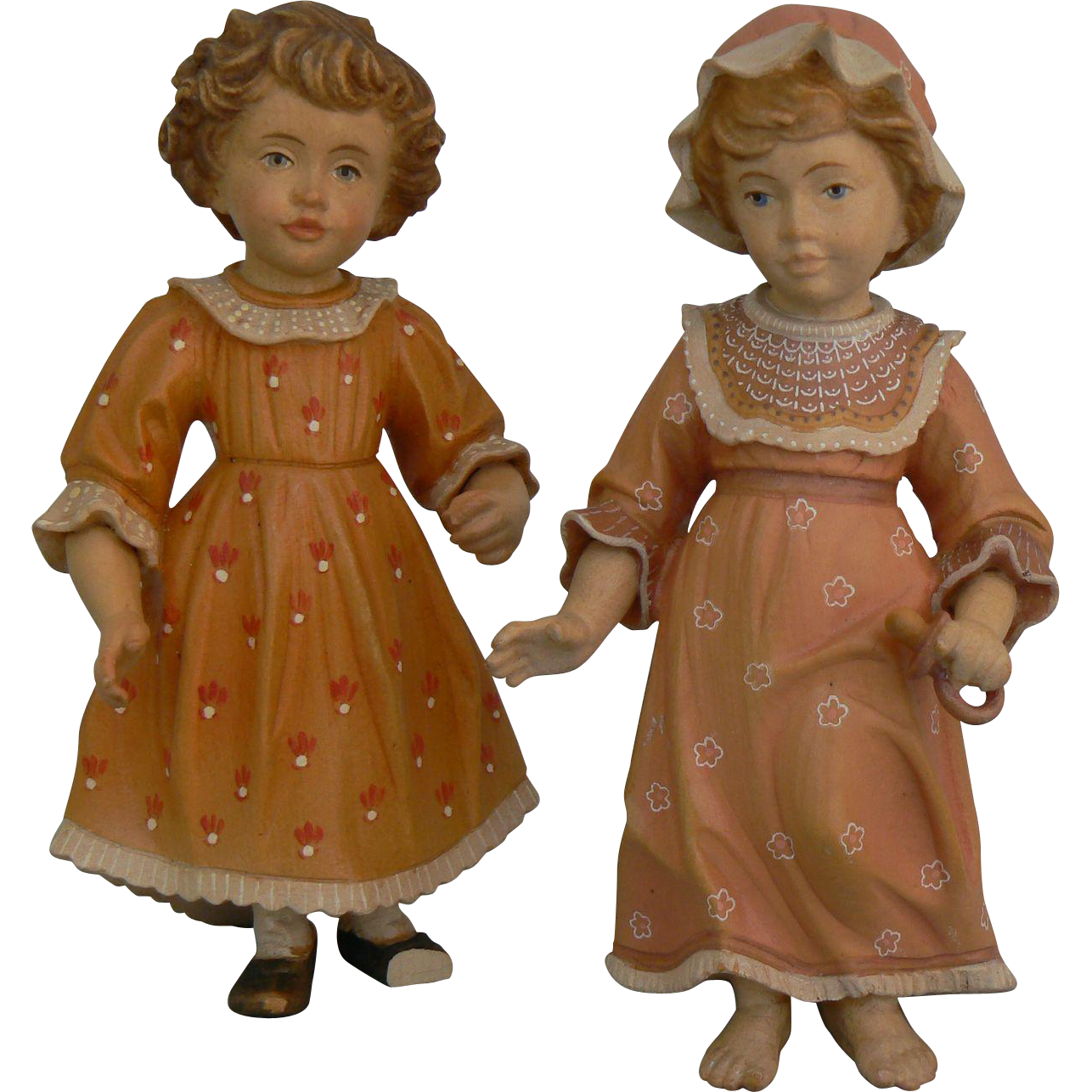 Wonderful pair of Wood dolls great detail and hand painted and Numbered.
