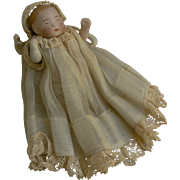 Tiny sweet all bisque German Toddler Baby doll all Original and great for a doll.