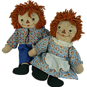 Georgene Raggedy Ann and Raggedy Andy awake / asleep black outline nose Pair of dolls.