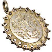 Antique Victorian English hallmarked 1880 sterling silver floral engraved locket pendant