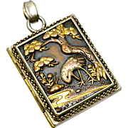 Antique Meiji era shakudo crane and butterfly two sided silver book locket