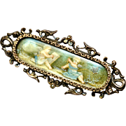 Antique Victorian sterling silver seed pearl framed painted cherub or cupid scene brooch