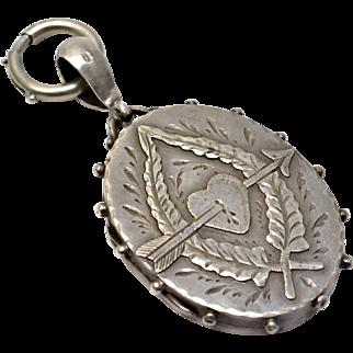 Antique Victorian English hallmarked 1887 sterling silver aesthetic era arrow through heart locket pendant