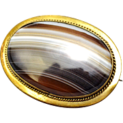 Antique Victorian 10k gold framed striped agate oval brooch pin