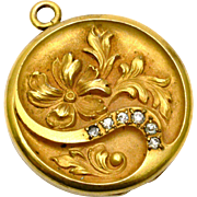 Antique Art Nouveau gold filled repousse rhinestone floral locket pendant