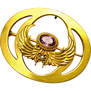 Antique Art Nouveau oval gilt brass amethyst glass and seed pearl angel wing sash pin brooch