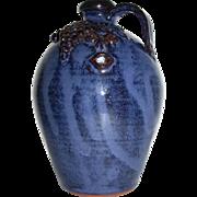 Jack T. Maness Southern Folk Art Pottery Face Jug with Tongue and Grapes (North Carolina)