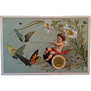 Merrick Thread ~ Cupid on spool pulled by Butterflies Trade Card