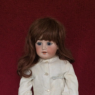 S&H DEP 1010 size 14. Antique bisque doll 31.5 inches tall.