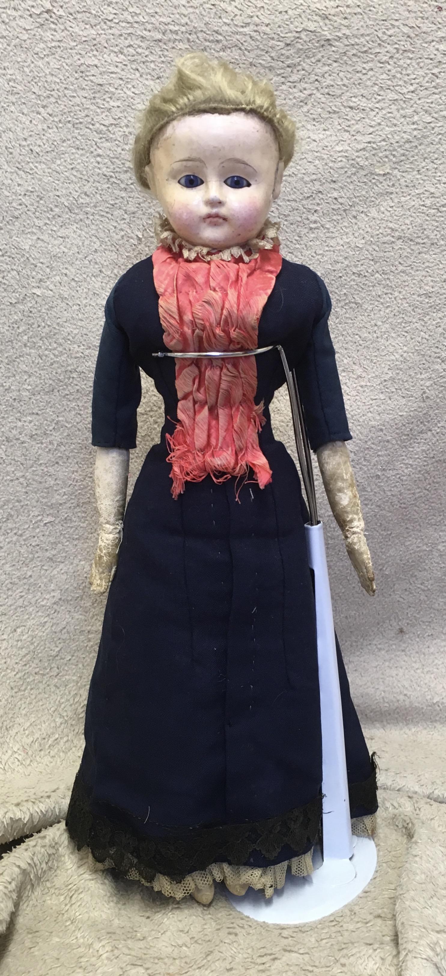 Antique paper mache fashion doll.