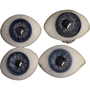 Odd Antique paperweight  glass eyes