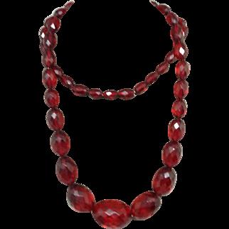 Cherry Amber/ Bakelite Faceted Beads