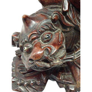 Chinese Man Riding Lion