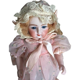 Two adorable small dresses with bonnet for small doll