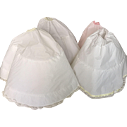 Four Cissy size formal Alexander slips