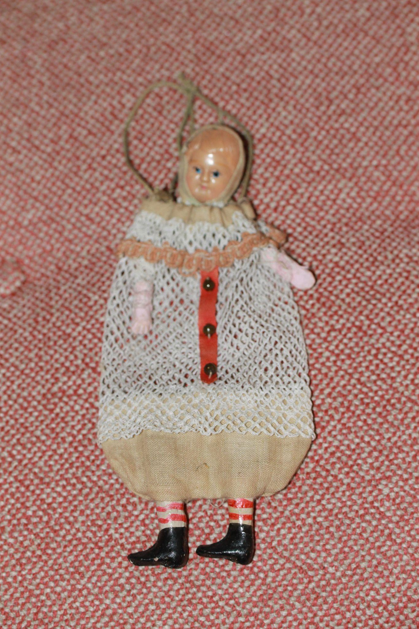 Celluloid Christmas Bag Doll Charming!