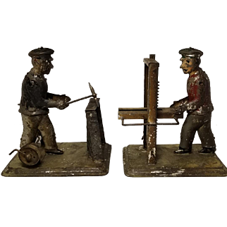 Pair of Early Strauss Tin Clockwork Toys