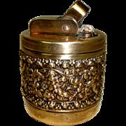 Elaborate Vintage Brass Table Top Lighter w/ Ornate Embossed Dancing Cherubs / Putti