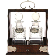 English Silver, Wood and Crystal Two Bottle Tantalus Set with Wine Labels.