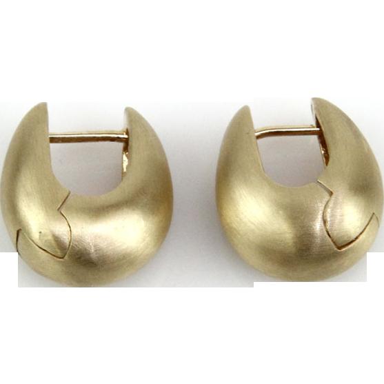 Pair of 14 Karat Yellow Gold Huggie Earrings.