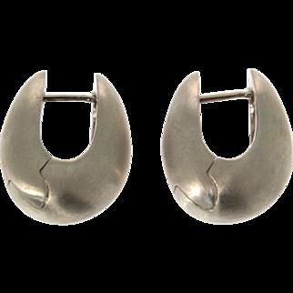 Pair of 14 Karat White Gold Huggie Earrings.
