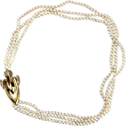 14 Karat Yellow gold Diamond and Pearl Necklace