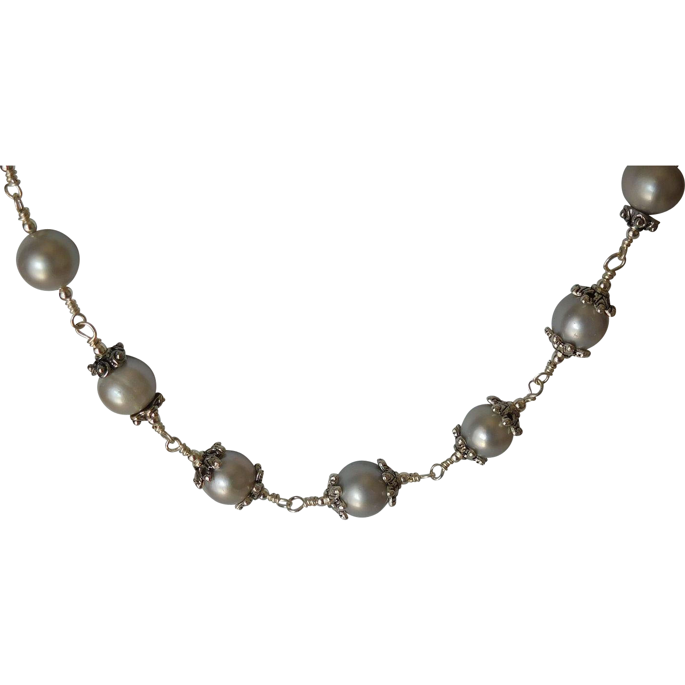 Pearls and silver  continuous strand necklace
