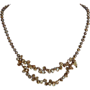 Pearls, crystals and gold necklace