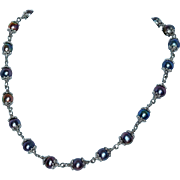 Deep Blue to silver gray fresh water cultured pearls are used to make this stunning necklace