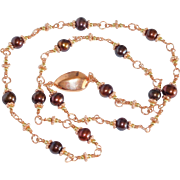 Fresh water cultured pearls and copper metal necklace