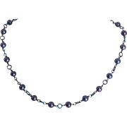 Cultured fresh water pearls and 100 percent titanium metal necklace