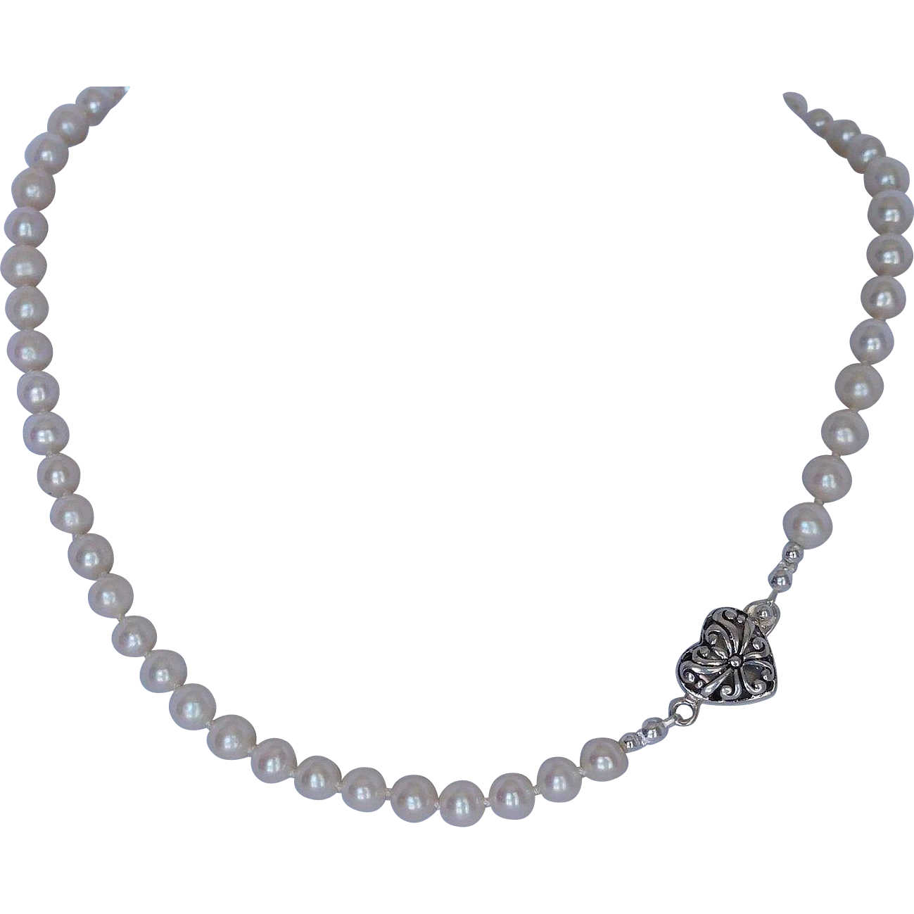 Fresh water cultured pearl necklace with sterling silver heart shaped clasp