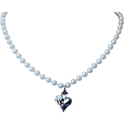 A contemporary classic fresh water cultured pearl and sterling silver necklace