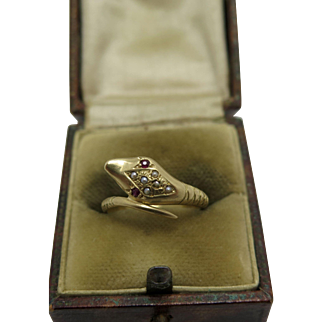 A French Victorian 18k gold snake ring with Garnet & seed Pearl setting