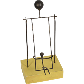 Vintage Interactive Moving Swinging Child Metal Art Sculpture on Yellow Base