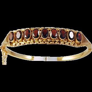 Antique Garnet Rose Gold 14 kt ( 585) Hinged Bracelet 9 Faceted Oval Garnets Makers Mark: AI Gorgeous!