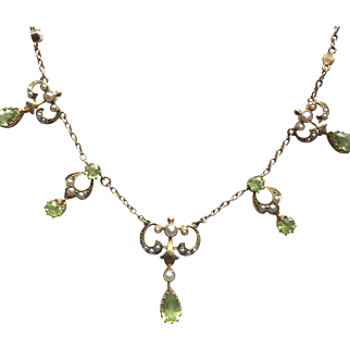 15K  Art Nouveau Festoon Necklace with Peridot and Seed Pearl Decorated Dangles